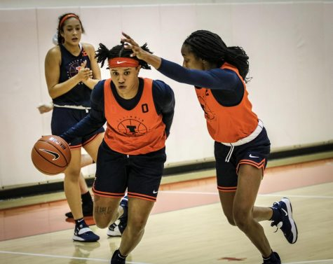Junior guard J-Naya Ephraim dribbles past teammate Lyric Robins during practice on Thursday.