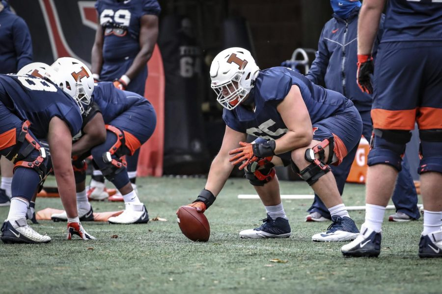 Senior+offensive+lineman+Doug+Kramer+prepares+to+snap+the+ball+during+practice+on+Oct.+15.+The+Illini+will+face+the+Badgers+on+Friday+at+Camp+Randall+Stadium+in+Madison%2C+Wisconsin.