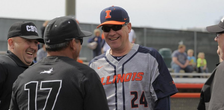 Illinois baseball Head Coach Dan Hartleb speaks with the umpires before a game.