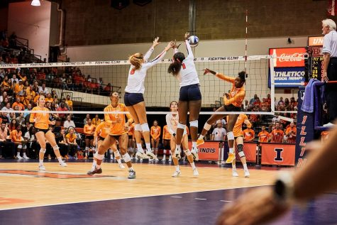 Sophomores Kyla Swanson and Kennedy Collins block a spike during the match against Tennessee on Sept. 1, 2019. Collins and two of her teammates stayed in touch last semester to workout over zoom.