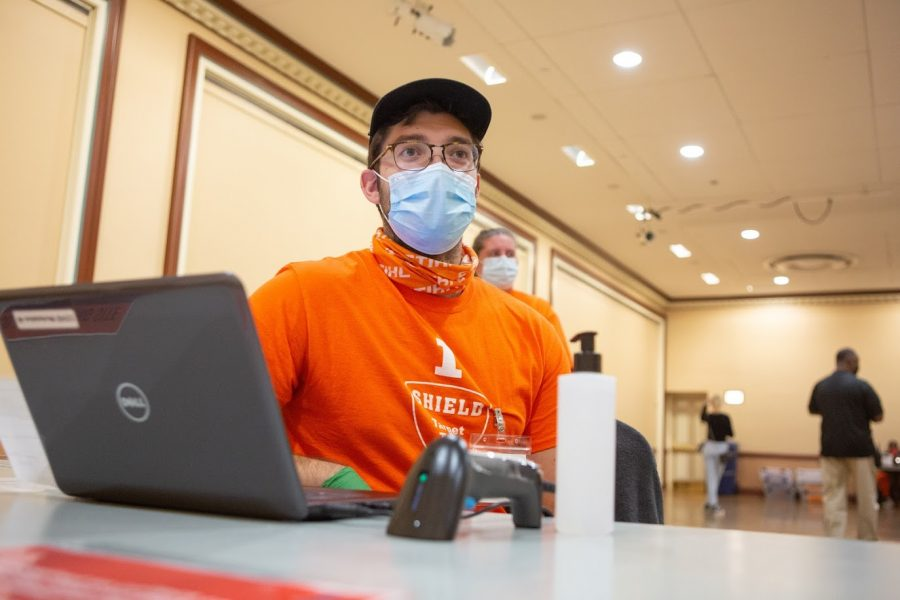 A coronavirus test site worker waits for students to arrive at the Illini Union test site on Oct. 30.
