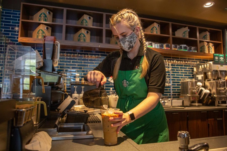 Junior Paulina Chmiel pours a drink before serving it to a customer during her shift at the Starbucks located on Oregon Street on Wednesday morning. Starbucks worker Aaliyah Johnson has found a comfortable balance between academics and work this semester.