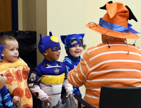 Children trick-or-treat at the Worcester Senior Center in Worcester, Massachusetts on Oct. 31. The mayors of both Urbana and Champaign are encouraging residents to take precautions against COVID-19 during trick-or-treating this Halloween.