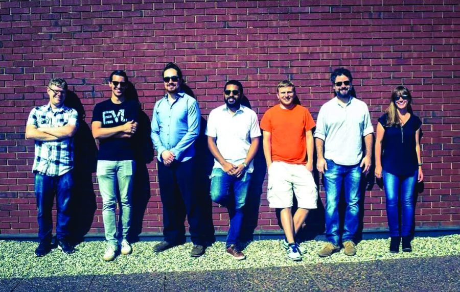 Jazz musician Jose Guzman poses with his bandmates for a full band photo.
