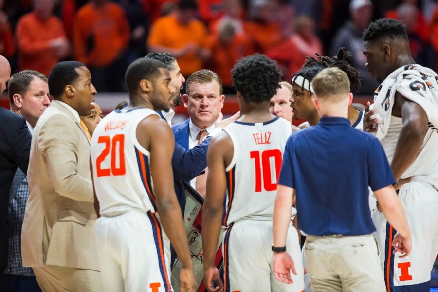Illinois head coach Brad Underwood speaks to his team during a time out at the game against Minnesota on Jan. 30.