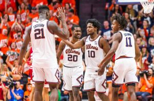 The Illinois men's basketball team celebrates a successful play during the game against Indiana on March 1.