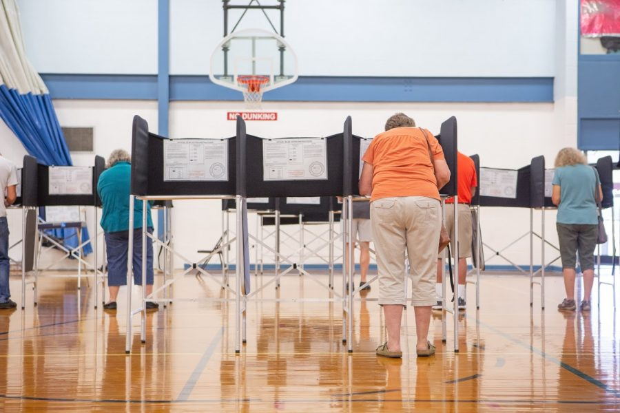 Champaign County residents vote at the Brookens Administrative Center in Urbana, Illinois on Sept. 24. Polling locations nationwide have implemented COVID-19 precautions.