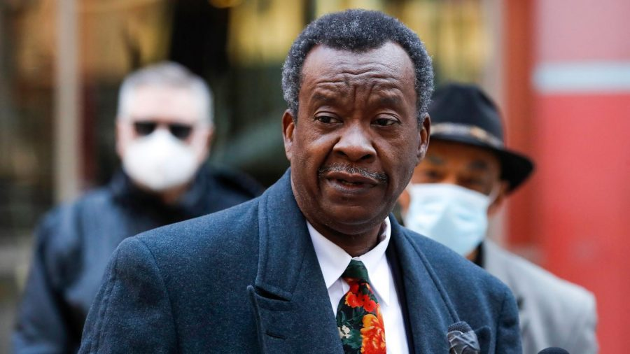 Willie Wilson departs a news conference at the Thompson Center in Chicago on May 12. Wilson is running as an independent under the Willie Wilson Party.
