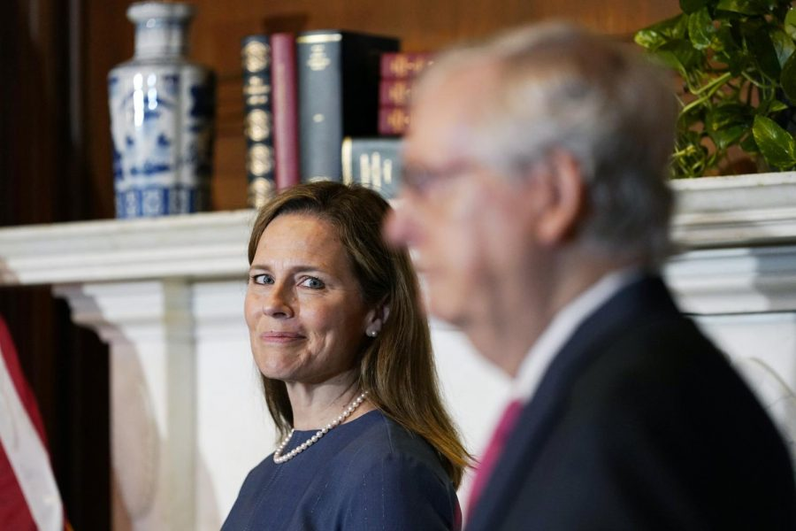 Seventh U.S. Circuit Court Judge Amy Coney Barrett, meets with Senate Majority Leader Mitch McConnell as she begins a series of meetings to prepare for her confirmation hearing on Sept. 29.