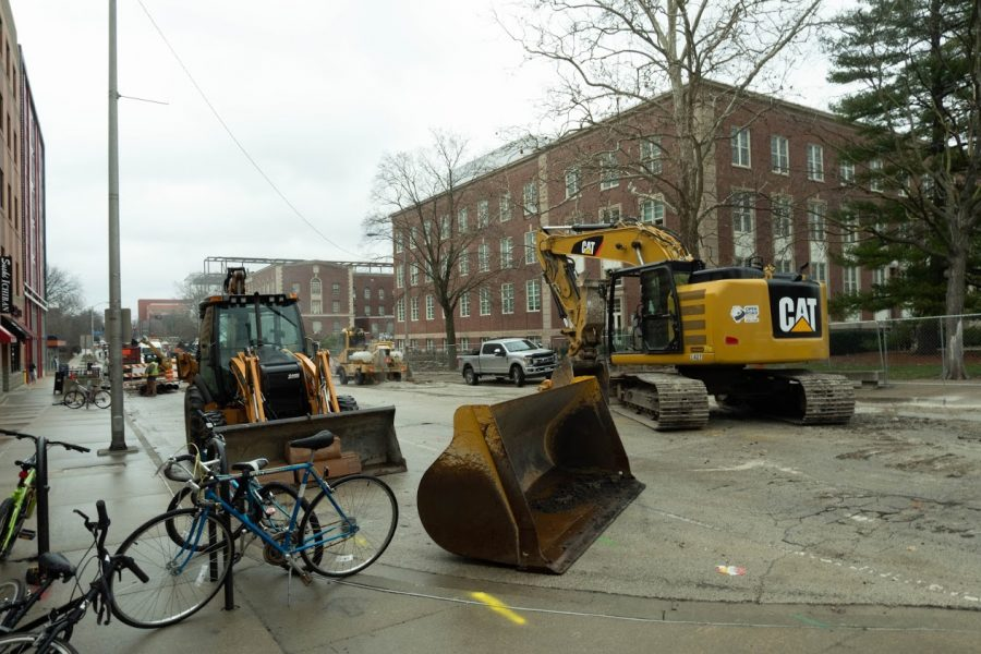 Construction equipment rests on Wright street on March 16, blocking part of the road. Several roads in Champaign will be closed this week for construction.