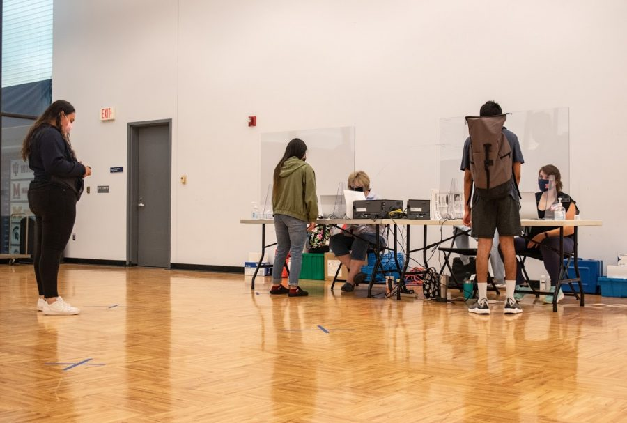 Student voters check in at tables in Multi-Purpose Room 7 at the ARC on Friday.