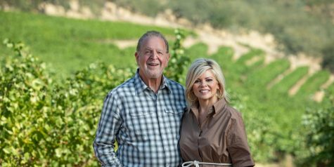 Richard and Leslie Frank pose for a photo at their vineyard. The Franks have recently donated $7.5 million to the College of Media