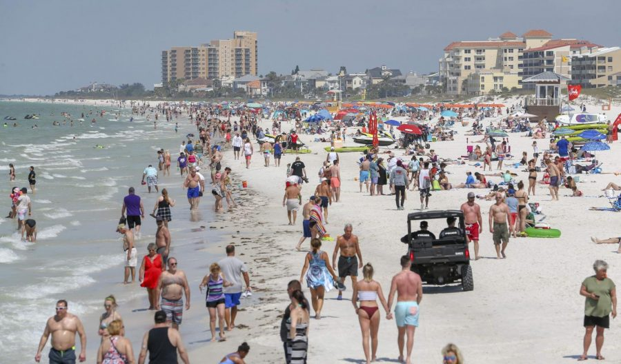 Beachgoers enjoy a day in the sun on a beach in Florida during Spring Break 2019.