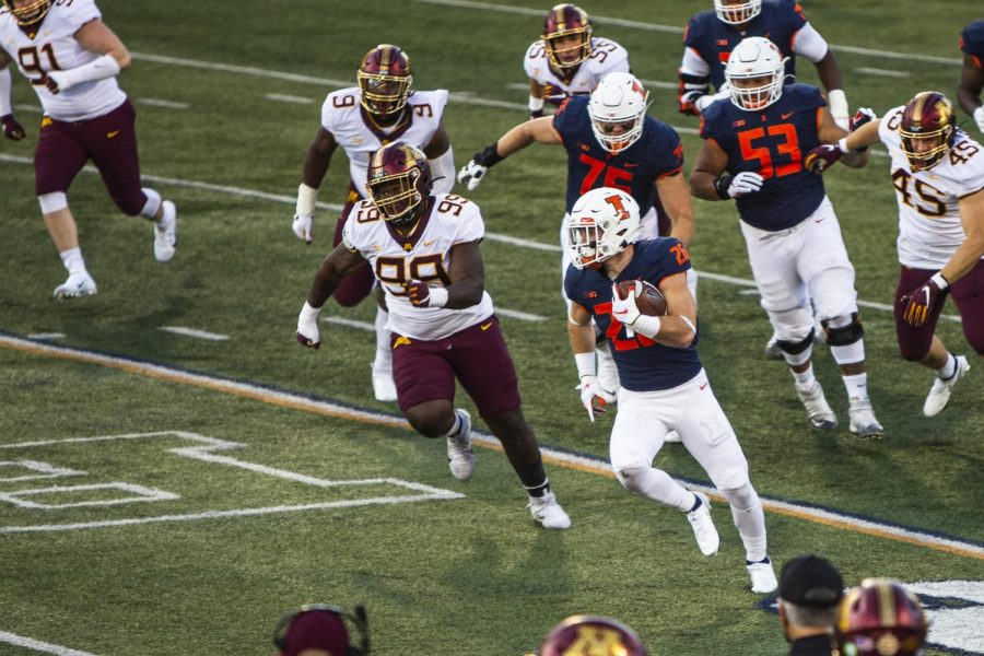 Junior Mike Epstein runs the ball down the field in Illinois' game against Minnesota on Saturday evening. The Illini lost to the Gophers 41-14.