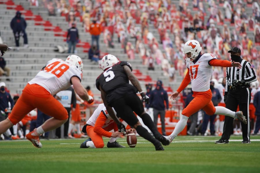 Senior kicker James Mccourt kicks a field goal during the game against Nebraska on Saturday.