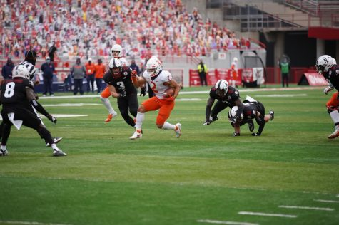 Running back Chase Brown advances the ball during the game against Nebraska on Saturday.