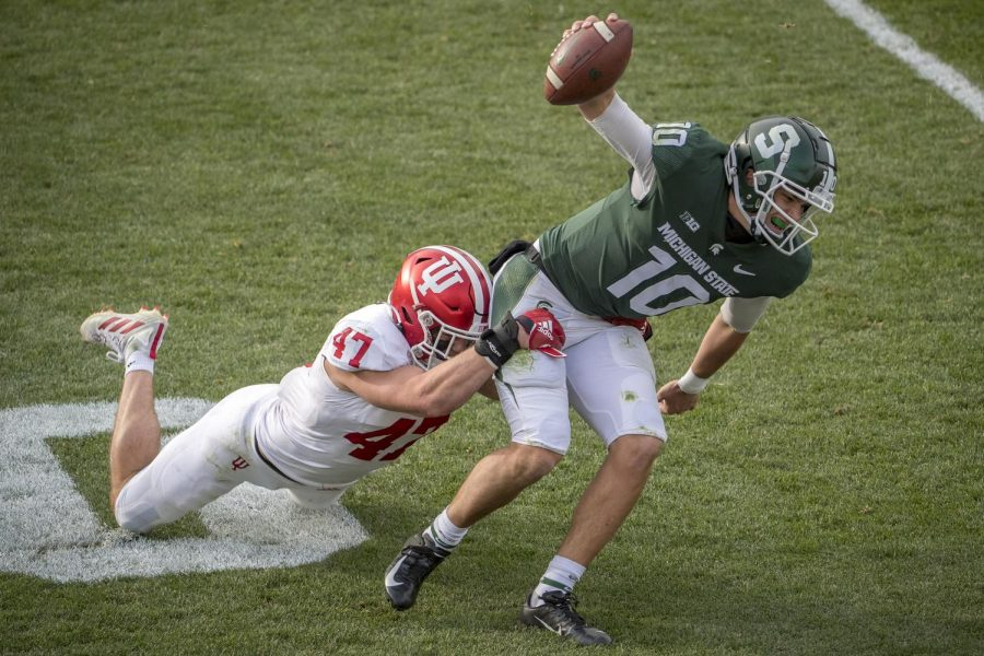 Indiana's Micah McFadden tackles Michigan State's Payton Thorne during the fourth quarter at Spartan Stadium on Saturday.