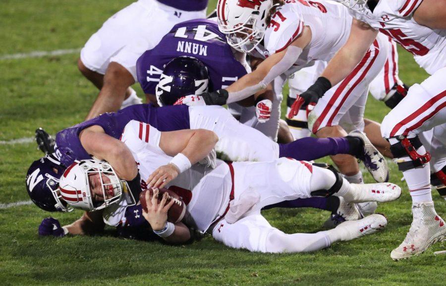 Northwestern linebacker Blake Gallagher sacks Wisconsin quarterback Graham Mertz in the fourth quarter on Saturday at Ryan Field in Evanston, Illinois. Northwestern won the game 17-7.