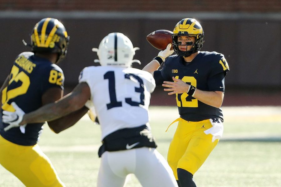 Michigan quarterback Cade MacNamara  looks to throw a pass in the first quarter of the game against Penn State at Michigan Stadium in Ann Arbor on Saturday.