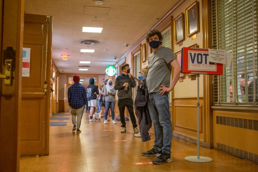 Students stand in line to vote at the Illini Union polling place on Tuesday.