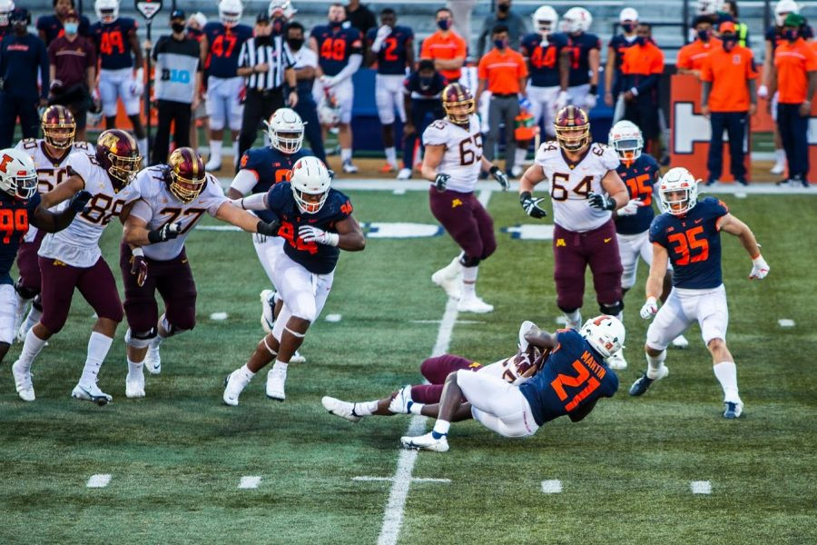 Junior defensive back Jartavius Martin tackles a Minnesota player during the game against Minnesota at Memorial Stadium on Saturday. The Illini lost the game 41-14.