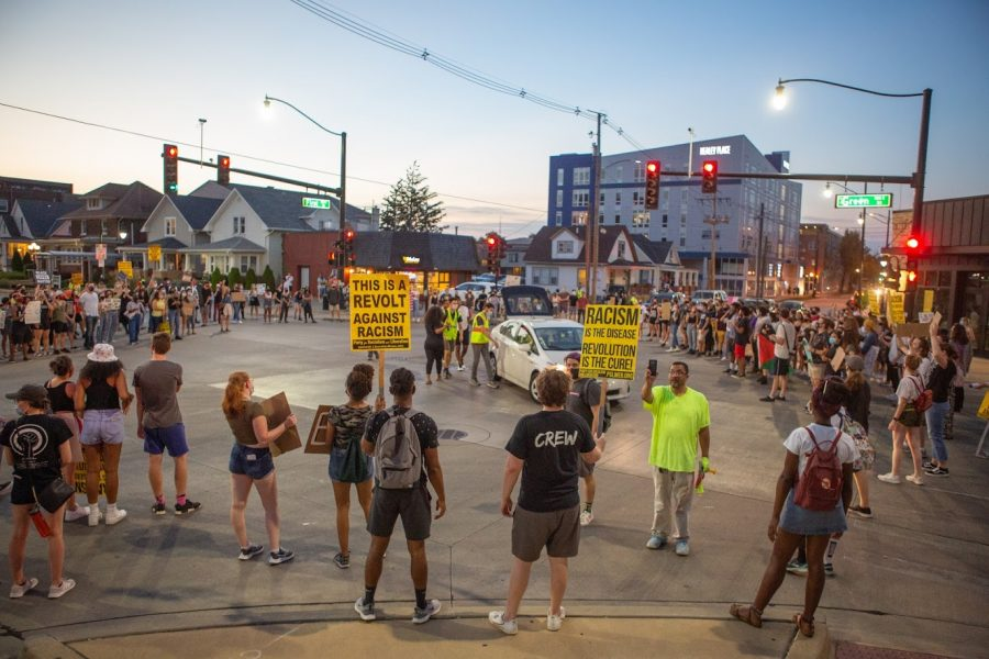 Demonstrators converge at the intersection of Green and First streets to listen to speakers during the CCARC protest on Aug. 28. CCARC is one of the local organizations raising money for Ale'yah Lewis.