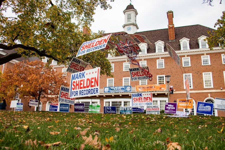 Lawn signs line the grass of the Main Quad outside of the Illini Union voting site on Thursday. Many important state positions are up for grabs in the 2020 Illinois election.