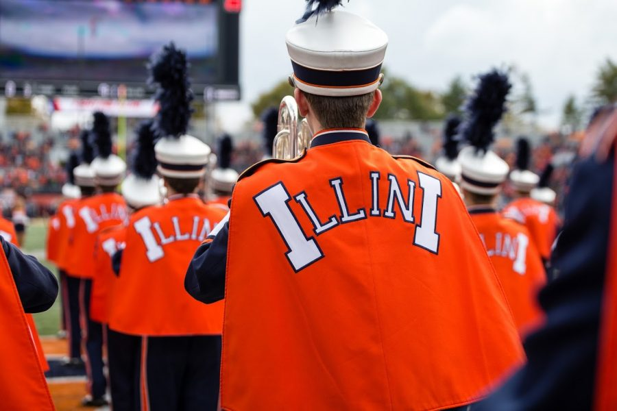 Members of the Marching Illini stand in the end zone before the game against Minnesota at Memorial Stadium on Nov. 3, 2018. The Marching Illini recently performed during the 100th anniversary of the Altgeld bells.
