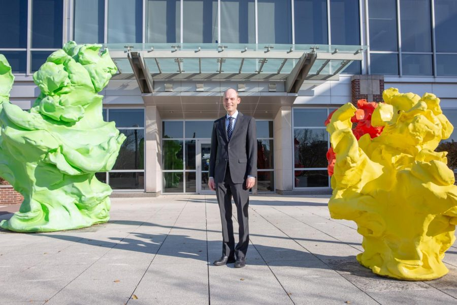 Dr. Erik Nelson poses outside the Institute for Genomic Biology on Saturday. Nelson has secured $4.5 million in funding from the United States Department of Defense.