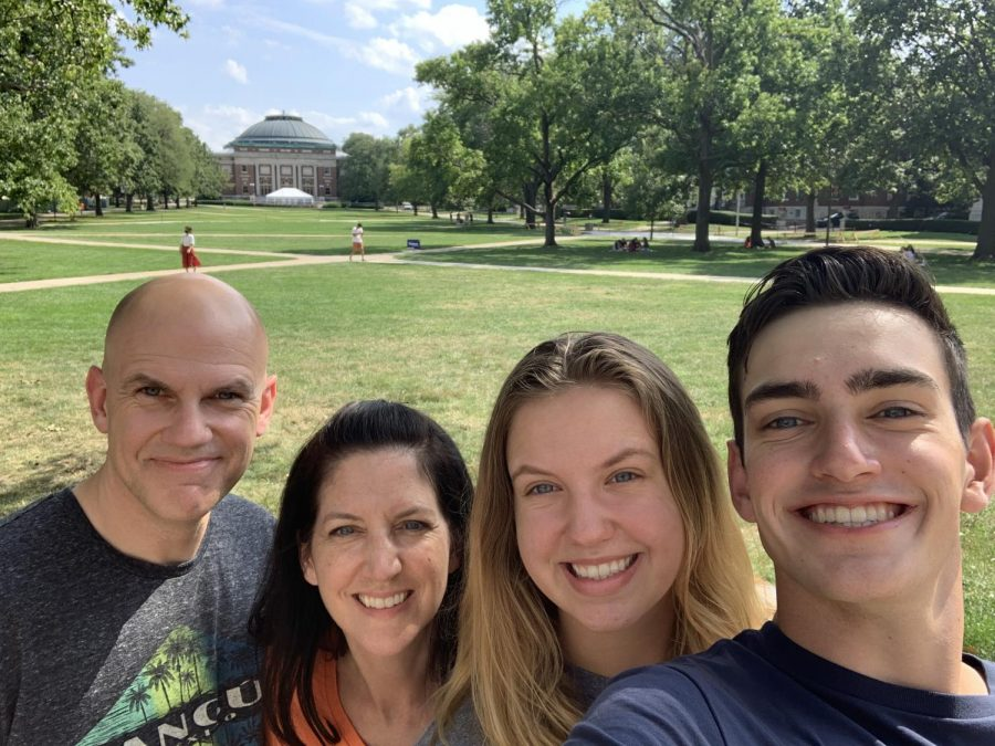 John, Anita, Emma and Ethan DeValk pose for a photo on the Main Quad. The DeValk parents were reluctant to send their children to campus during the COVID-19 pandemic.