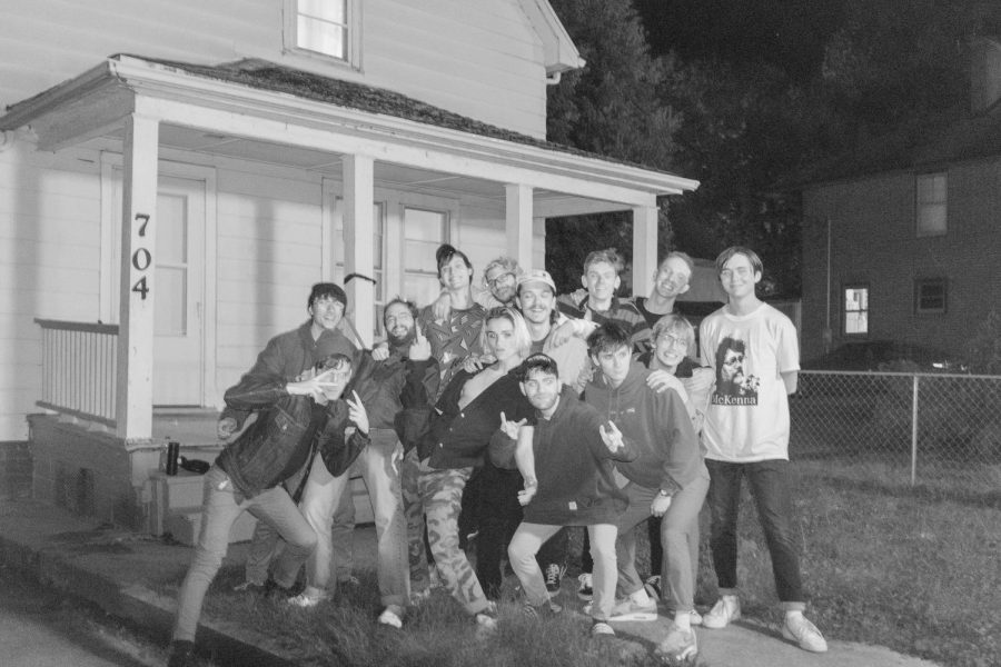 Members of the local band Camp Edwards pose outside the American Football House after performing in October 2019. American Football feature the house on their album cover.