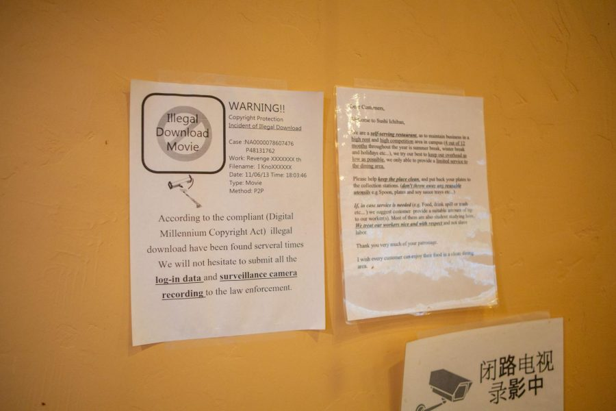 A+sign+resting+on+the+wall+of+Sushi+Ichiban+instructs+customers+not+to+illegally+download+files+using+the+restaurant%E2%80%99s+wifi.+