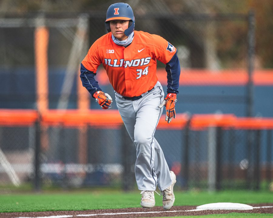 Junior Ryan Hampe runs the bases during the Orange and Blue series on Nov. 2. Hampe hit .500 in the series.