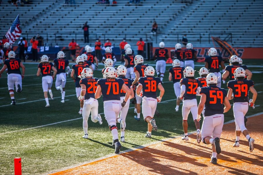 The+Illinois+football+team+takes+the+field+before+the+game+against+Minnesota+on+Saturday.+Illinois+fell+41-14+and+struggled+to+count+on+Minnesota+running+back+Mohamed+Ibrahim.