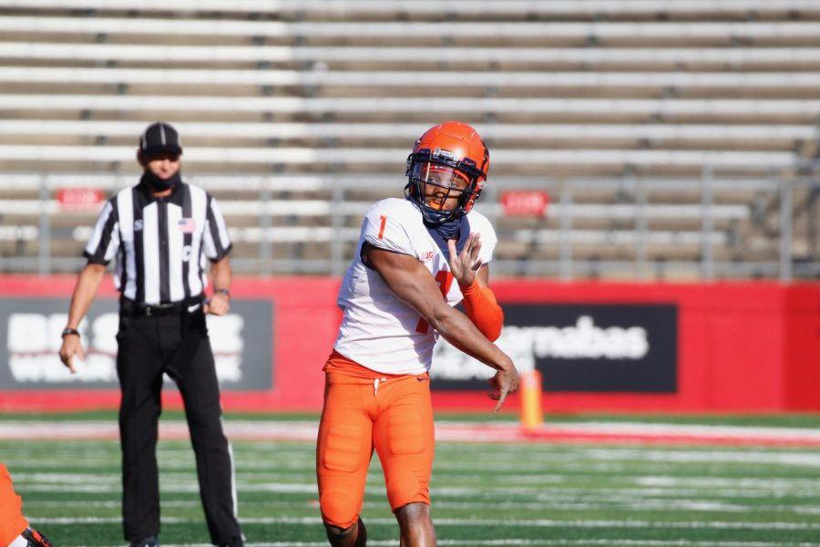 Redshirt freshman quarterback Isaiah Williams throws a pass during the game against Rutgers on Saturday. Illinois won the game 23-20.