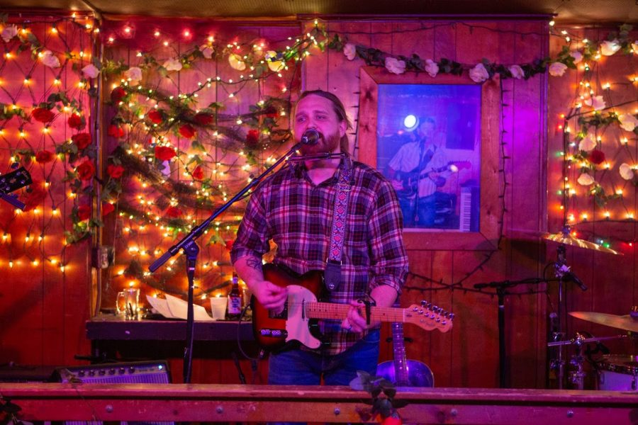 A local artist performs at the Rose Bowl Tavern on Feb. 29. The Rose Bowl Tavern is one of the Urbana business that has received a COVID-19 grant.