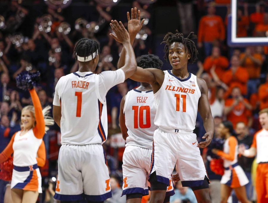 Aya+Dosunmu+and+Trent+Frazier+high+five+each+other+during+Illinois%27+game+against+Nebraska+on+Feb.+24.+The+Big+Ten+released+the+2020-2021+conference+schedule+Wednesday.