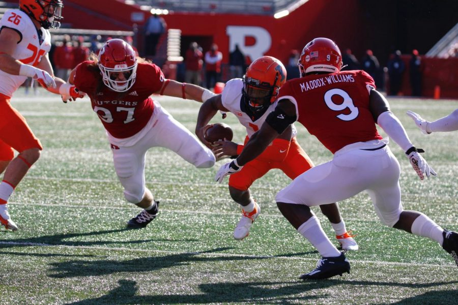 Illinois quarterback Isaiah Williams runs the ball against Rutgers on Saturday. The Illini won 23-20..