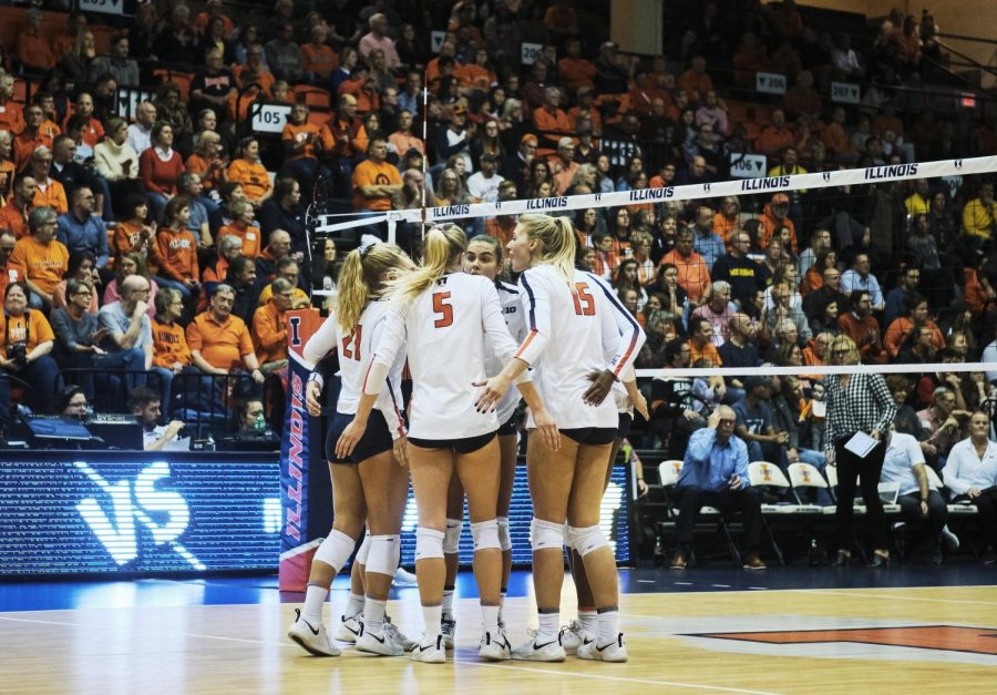 The Illinois volleyball team huddles up in a match against Michigan on Nov. 1, 2019. The volleyball team was one of the many Illinois programs to have players sign National Letters of Intent on Wednesday.