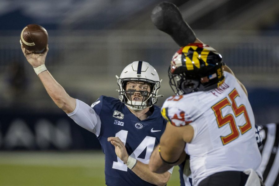 Penn State quarterback Sean Clifford throws under pressure from Maryland's Austin Fontaine during the second half at Beaver Stadium in State College, Pennsylvania, on Saturday.