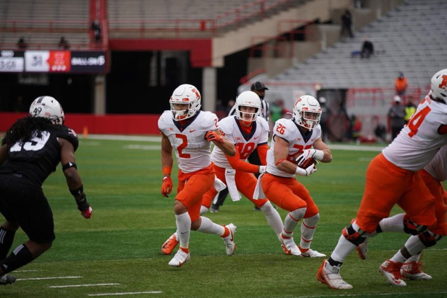 Running back Mike Epstein runs the ball during the game against Nebraska on Saturday. The Illini won 41-23.