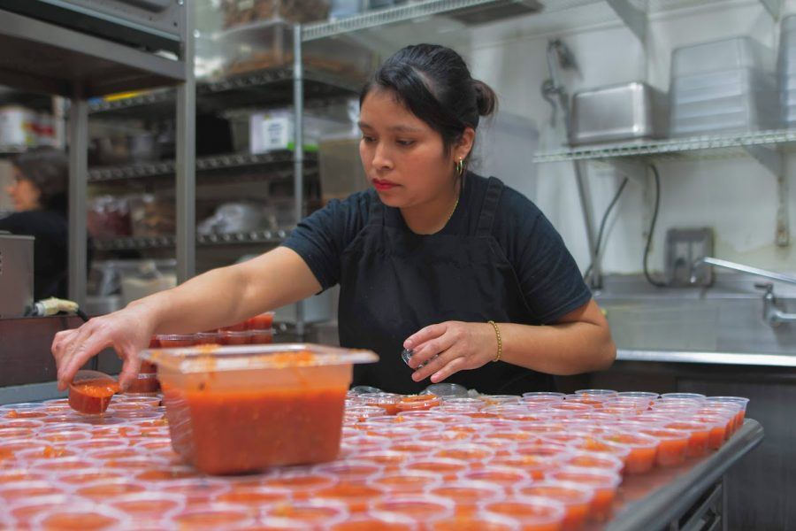 A worker at Maize Mexican Grill preps for the lunch rush on Feb. 9.