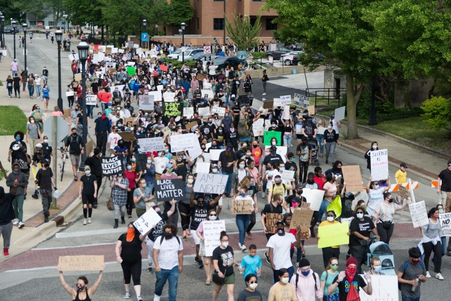 Protestors march down Elm St during a demonstration following the death of George Floyd on June 1.