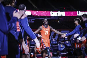 Sophomore Kofi Cockburn high-fives his teammates as he enters the court during the game against Chicago State on Thursday. The Illini won 97-38.