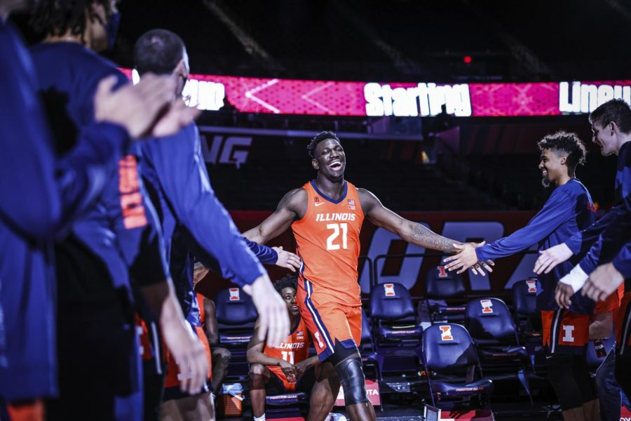 Sophomore+Kofi+Cockburn+high-fives+his+teammates+as+he+enters+the+court+during+the+game+against+Chicago+State+on+Thursday.+The+Illini+won+97-38.