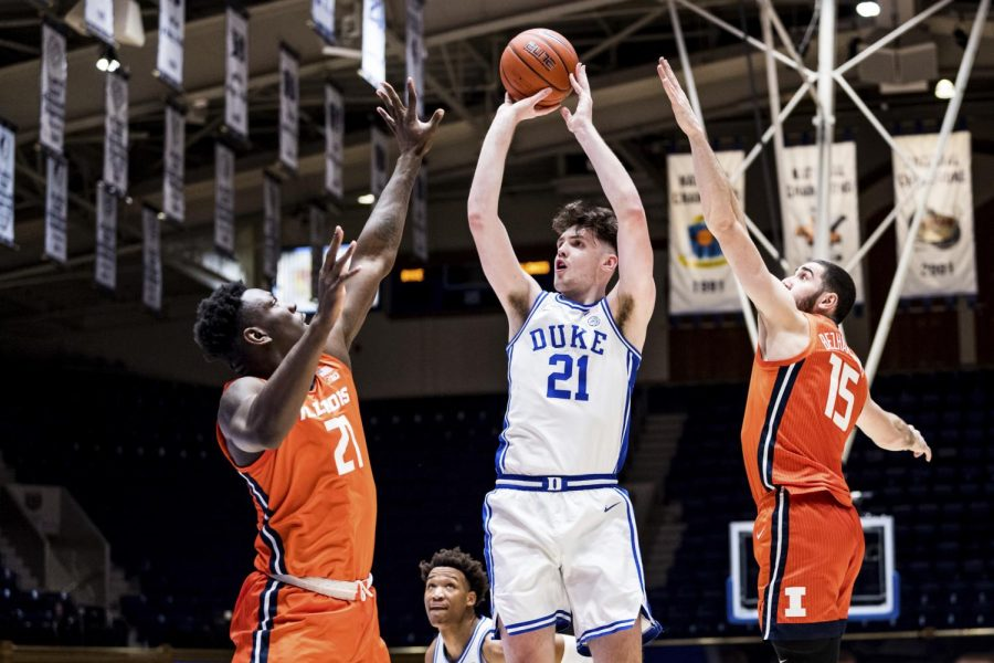 Illinois players Kofi Cockburn and Giorgi Bezhanishvili attempt to block a shot from Duke's Matthew Hurt during the game between the two teams on Tuesday. The Illini won the game 83-68.