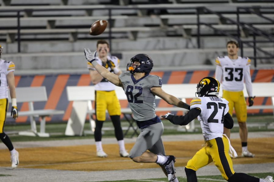Junior Luke Ford reaches for a pass during the game against Iowa on Saturday.