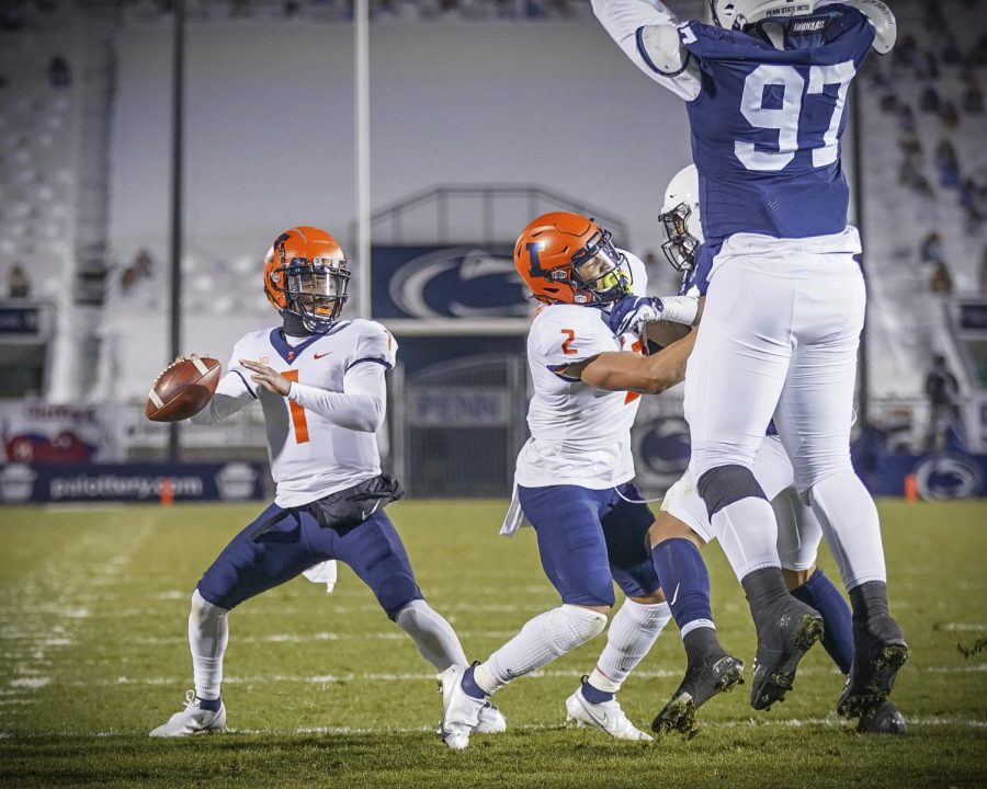 Quarterback Isaiah Williams throws a pass during the game against Penn State on Saturday. The Illini lost the game 56-21.