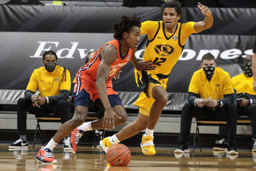 Junior Ayo Dosunmu advances the ball during the game against Mizzou on Saturday. The Illini fell to the Tiger 81-78.