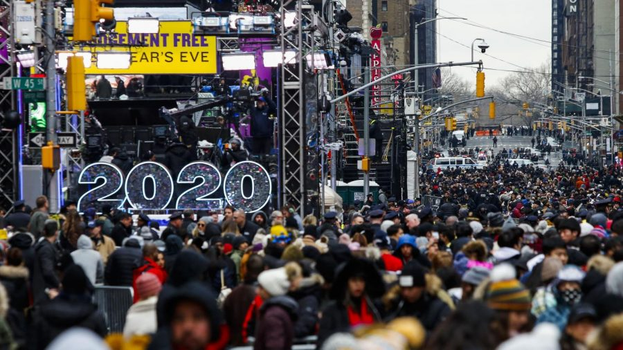 People wait to celebrate New Year's Eve in Times Square on Dec. 31, 2019 in New York City.